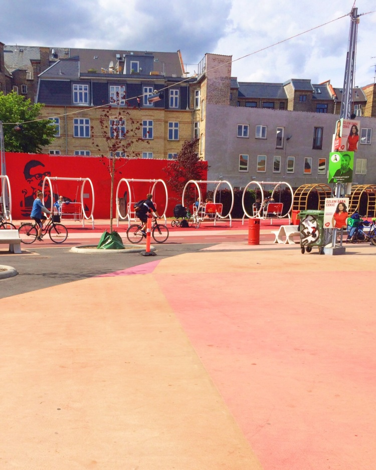 The circular swings along the mural